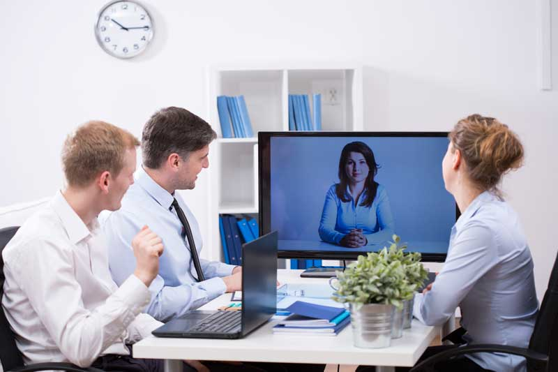business people on Skype